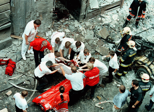 Medics carry a body of a car bomb victim in downtown  Budapest July 2. The powerful bomb killed four..